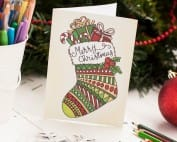 Free printable Christmas coloring card – Printable coloring template to create your own cute DIY Christmas card for family and friends | Find more Christmas printable activities and coloring pages at www.sarahrenaeclark.com/christmas