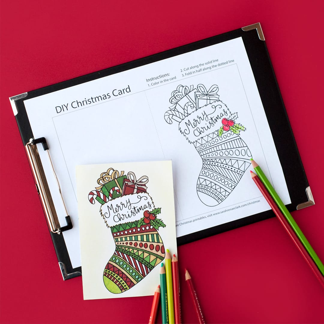 This free printable Christmas card is fun to color in and a great way to personalize your Christmas gifts! This is a sample card from my pack of 20 coloring cards for Christmas #free #christmas