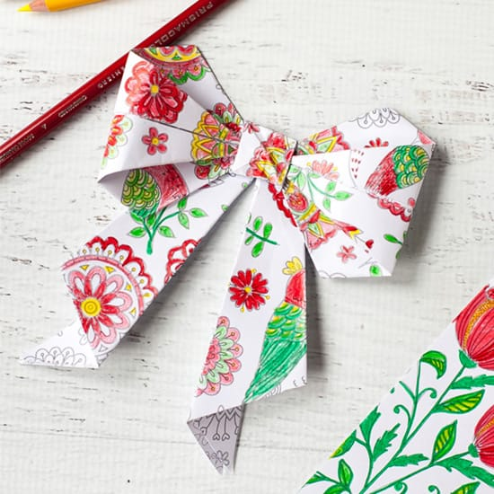 Turn yoru coloring pages into origami bows | Click to see all 29 creative ways to repurpose your coloring pages | #coloringpage #crafts www.sarahrenaeclark.com