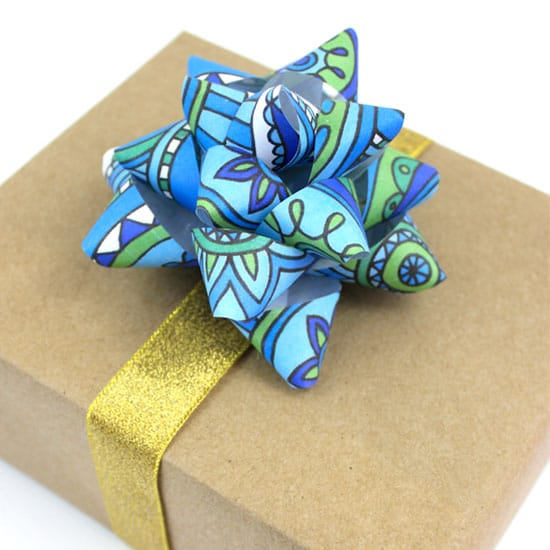 Use a coloring page to make a gift bow | Click to see all 29 creative ways to repurpose your coloring pages | #coloringpage #crafts www.sarahrenaeclark.com