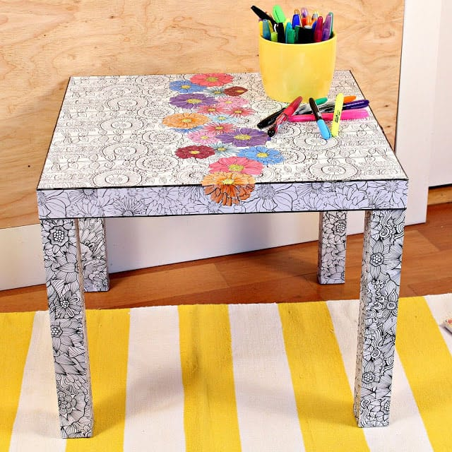 an adult coloring book ikea table hack! | Click to see all 29 creative ways to repurpose your coloring pages | #coloringpage #crafts www.sarahrenaeclark.com
