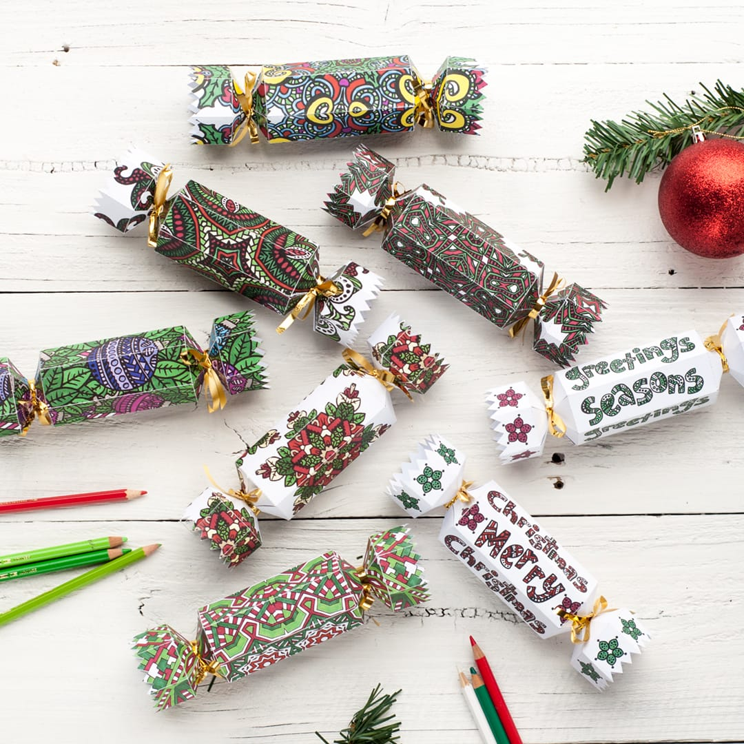 Make your own Christmas crackers with these 8 coloring cracker designs! | Find more Christmas printable activities and coloring pages at www.sarahrenaeclark.com/christmas